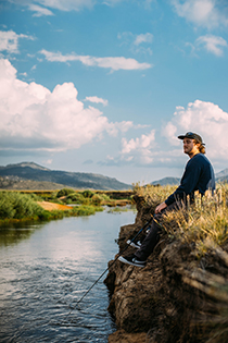 Man fishing on a bank using BAITCAMP